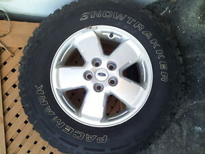 4 winter tires on alloy rims like new