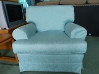 A lovely arm chair and footstool in excellent condition. Part of a three piece suite.