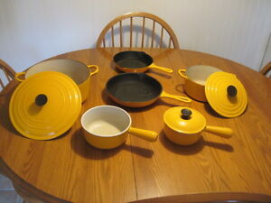 Nine Piece Set of Vintage Creuset Pots and Pans