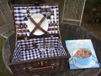 Wicker picnic basket for two persons, with plates and cutlery.