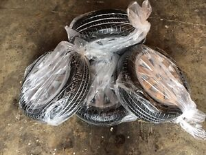 195/65R15 Continental All Season Tires w Steel Rims & VW Hubcaps