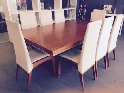 Stylish wooden dining table with 8 matching upholstered chairs Moorebank Liverpool Area Preview