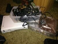 1x Xbox 360 - 1x xbox crystal and various cables/xbox remote/controllers for spare parts