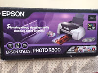 Epson Stylus Photo R800 printer in good condition and working order. Includes 17 Epson cartridges.
