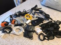 Bundle of accesories, including 3D glasses, headphones and miscellaneous internet cables