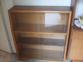 Wooden display cabinet with sliding glass doors