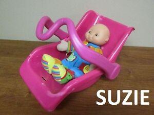 Porte bébé + poupée les 2 pour $5.00