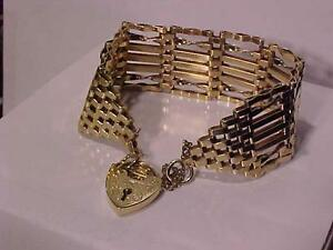 #3104-OLDER 9K YELLOW GOLD GATE BRACELET(ENGLISH 1980`S) HEART LOCK CLOSURE