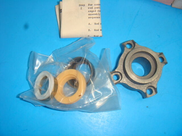 1 NEW MILLER HYDRAULIC CYLINDER PISTON ROD SEAL AND BOLTED BUSHING, 051-KR015-63