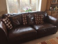 2 dark brown leather sofas in very good condition.