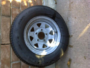 ST 185-80 Carlise trailer tire is mint rim is stained but not da