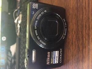 NIKON COOLPIX S7000 16.1 Digital Camera with 3.0-Inch TFT LCD.