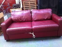 Maroon pull out sofa available ASAP