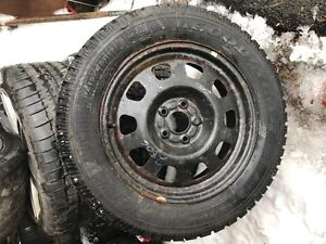 One never used 215/65/17 Goodyear Nordic on Dodge rim.