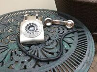 retro silver coloured telephone