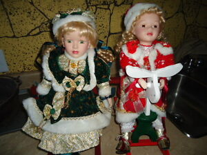 Two collectible dolls.