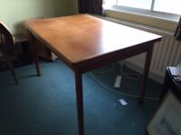 Wooden 1980's dining table and four chairs. Table seats 4 or more. Good condition.