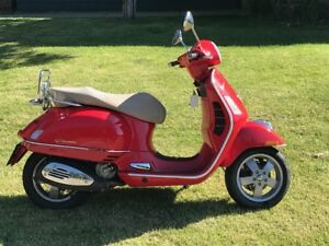 Red Vespa 250 GTS  ( reliable fuel injected and liquid cooled )