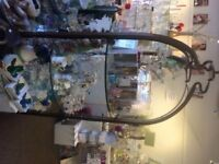 Large Ornate glass shelf metal legs display stand.