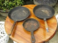 Three Cast Iron Skillets.