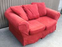 Red 2 seater with loose covers