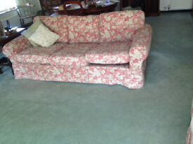 large comfy sofa with pinkish removable covers