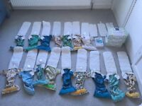 16 x Bambino mio reusable nappies, plus 3 booster inserts, 3 packs of liners & nappy cleanser