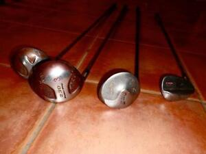 Various left handed golf clubs