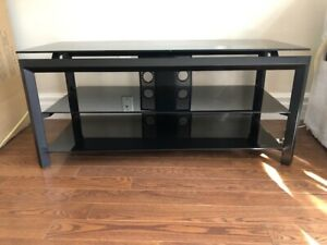Black metal tv stand with three black glass shelves