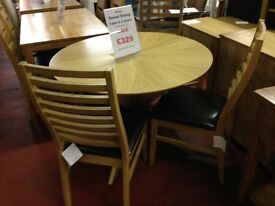 New round dining table with 4 new chairs only £349