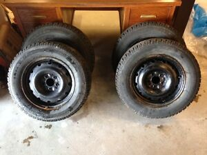 Set of 4- 215/70/R16 studded winter tires