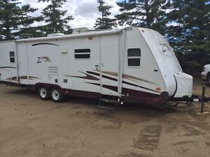 27' Zepplin by keystone trailer with slide, pull behind camper,