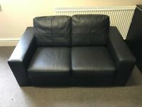 Small black leather settee