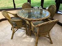 Wicker / Rattan Garden / Conservatory Dining table with cushions and centre table.