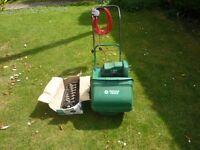 "Qualcast Suffolk Punch 12"" electric cylinder mower with scarifier/lawn rake"