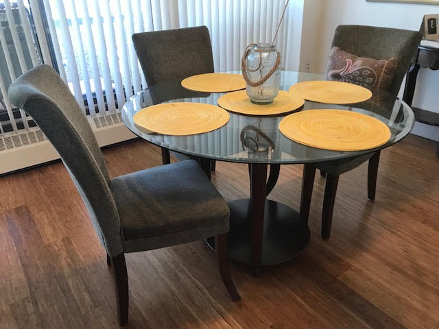 GORGEOUS THICK GLASS DINING TABLE SEATS 5 WITH OLIVE CHAIRS
