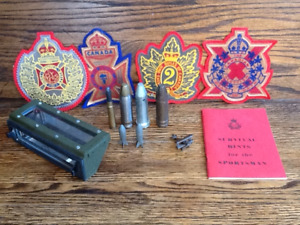 military artifacts: shells, toy airplane, 4 regimental badges