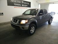 2009 Nissan Frontier LE 4x4 Crew Cab 139.9 in. WB