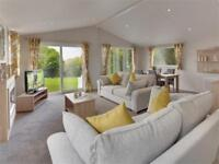 Luxury Clearwater Lodge with decking on 12 month Holiday Park.