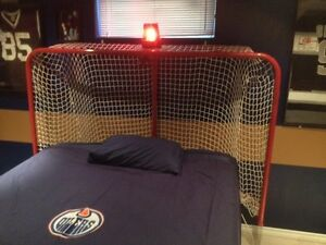 Custom hockey net headboard with motion activated goal light