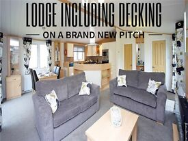 LODGE FOR SALE WITH DECKING ON A NEW PITCH near Great Yarmouth in Norfolk