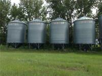 4- 2000 bu. Twister bins on cones. Located at Elstow, Sk.