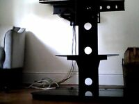 Black freestanding tv stand for mounting a flat screen tv