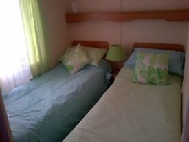 Static caravan for sale two double bedrooms , old type but lovely clean good condition, verandah,