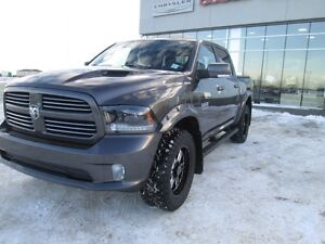 WOW. TAKE THIS LIFTED BEAUTY HOME TODAY. fULLY LOADED RAM 1500