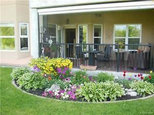 ST.VITAL MAIN FLOOR CONDO WITH RIVER VIEW !!