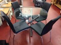 New round glass dining table with chrome legs & 4 chairs Only £359 get yours today