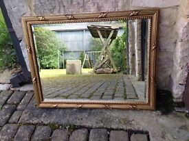 Mirror with gild-effect frame