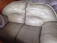 3 and 2 seater Leather sofas light green in good condition.