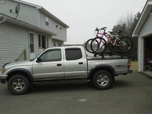 Tonneau cover plus Yakima bars and 3 bike racks